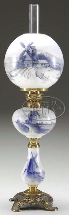 lighting, America, Junior banquet lamp, reference H2-428 similar, white milk glass shade font and stem decorated with blue delft decor mounted on brass plated metal foot  Circa 1850-1900