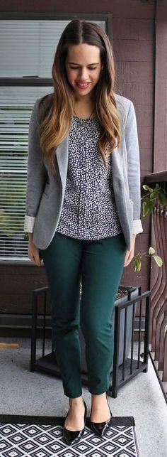 Black printed blouse, green pants, gray blazer, black flats