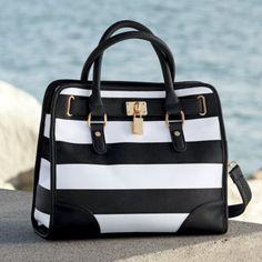 Wide Stripe Bag from Monroe and Main. Decorative goldtone padlock looks striking against crisp black and white stripes.