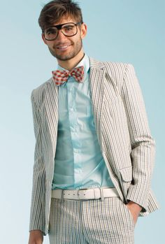 Colorful bow tie with light suit ~and all that is missing is a puppy, an icecream truck, and some chloroform.