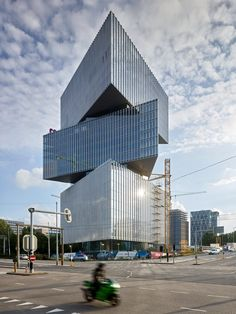 Dutch architect OMA has built the Nhow Amsterdam RAI Hotel in Amsterdam, which is made from three triangular volumes stacked on top of each other. Interesting Buildings, Amazing Buildings, Modern Buildings, Office Buildings, Oma Architecture, Sustainable Architecture, Residential Architecture, Contemporary Architecture, Triangular Architecture