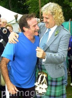 Billy Connolly jokes with fellow comedian Robin Williams after he ran the hill race at the Lonach Highland Games in Strathdon near Balmoral in Scotland.