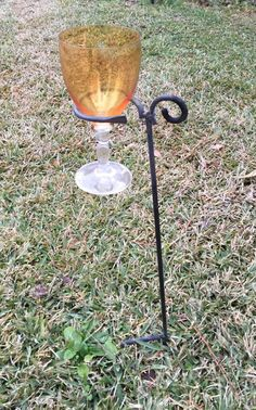 HAND FORGED WINE/DRINK RACK STAND. JUST PRESS INNTO THE LAWN NEAR YOUR CHAIR