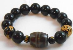 Tiger's Teeth DZI with Obsidian and Dragons to repel negative energy and ward off evil spirits.