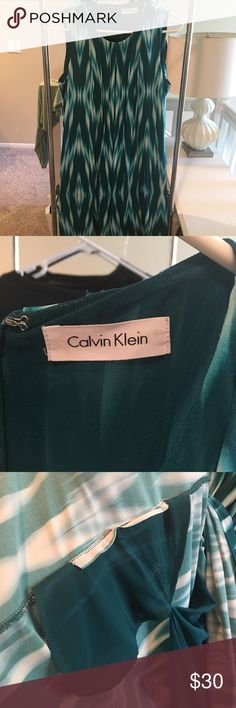 Calvin Klein dress Blue / teal midi dress - hits me right above the knee - amazing fabric - feels great and is super flattering ** i cut the size tag off so I think it's a L but I can't remember ** can dress up with heels but I have worn to work with flats Calvin Klein Dresses Midi