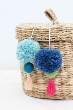 Are you looking for a simple project for your next craft night? We created this fun tutorial for DIY Pom Pom Tassel Baskets.