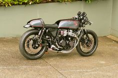 "Honda CB750 cafe - what beautiful lines. I'm a bit amazed that with the recent boom in Cafe's that there are only a handful of manufacturers catering to the desires. I guess it's the same thing with ""chopper"" style bikes, though."