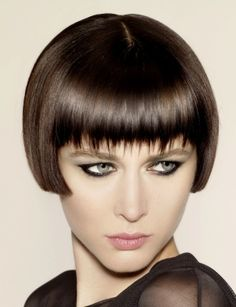 A short brown straight 1920s bob Shortfringe hairstyle by Hooker & Young