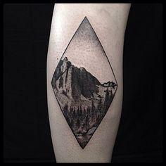 double diamond mountain tattoo. Great dotwork black and grey tattoo by Erik Jacobsen.