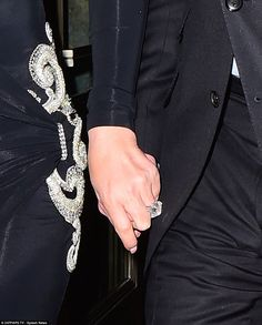 Holding hands: The duo emerged holding hands, Mariah's hand placed strategically on top...