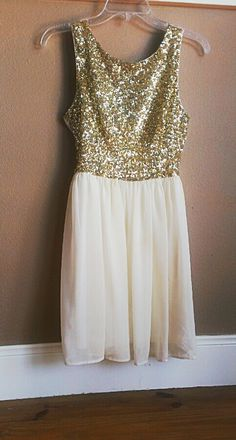 Gorgeous gold sparkly with chiffon skirt. Cute!