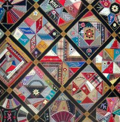 Crazy quilt seen at the Des Moines AQS Quilt Show. Notice how the 'crazy' blocks are really traditionally pieced.