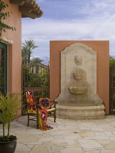 It's not Mediterranean without a lovely water feature! (and tile and terracotta:)