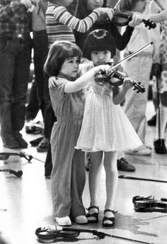 violins, not violence Betsy Varney and Jennifer Kersola of the Hoog-Leviton Suzuki Academy of Performing Arts in Des Plaines, Illinois. date...