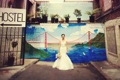 Urban San Francisco wedding photos with a graffiti mural and the bride by top San Francisco Wedding Photographer, Tinywater Photography