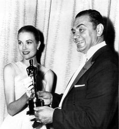 Ernest Borgnine receiving Best Actor Oscar in 1956 for Marty, from Grace Kelly.