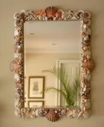 Seashell Mirror for the entry. I couldn't decide whether the white Greek Key Round mirror would be best or this one with all the shells.
