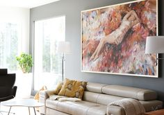The Scandinavian living room with colorful art and painted grey wall. Interior design by Marika Ritala-Mäkinen (Finland, Tampere).  Painting by Chingiz Abassov
