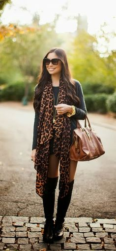 Lovely style with leopard scarf, black sweater and long boots