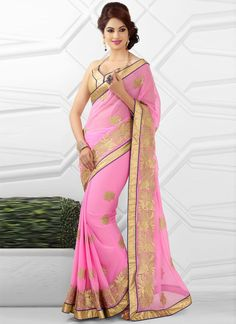 Stay ahead of the current trend just by stepping out in this breathtaking pink faux chiffon designer saree, it's beautifully prettified with heavy embroidery, resham embroidery, stone work and zari wo...