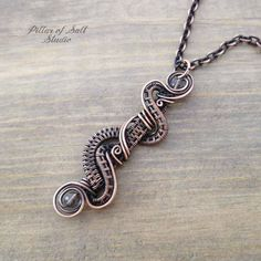 Handmade wire wrapped copper pendant. •Stone: Smoky Quartz (2 small beads at top and bottom). •Wire: solid copper, antiqued •Dimensions: The pendant measures approximately 2.25 long and about .5 wide. •Chain: solid copper, antiqued, with copper plated brass lobster clasp. It is