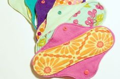 Reusable pads.  Seems a little gross at first, but would be better than hauling around days worth of sanitary supplies while surviving.