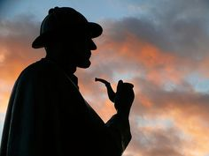 A nine-foot-tall statue of Sherlock Holmes stands outside the Marylebone exit to the Baker Street Tube station in London. Solemn and gaunt, Holmes looms over traffic in his trademark Inverness cape and deerstalker, pipe in hand. Sherlock Holmes, Inverness Cape, Building Society, The Imitation Game, Alan Turing, Dr Watson, Arthur Conan Doyle, Sir Arthur, Best Mysteries