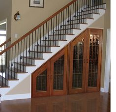 Another brilliant use of space for under the stairs! Wine!