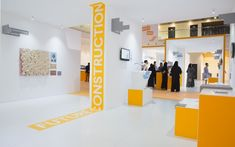 Global Grad Show is an exhibition of the most innovative projects from the world's leading design schools. Office Wall Design, Office Walls, Office Interior Design, Office Interiors, Building Columns, Dubai Design Week, Exhibition Plan, Floor Graphics, Event Signage