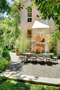 I'm debating whether to do a gravel patio. We want to wrap patio around the sunroom, meet gardens on other end. It's pretty big space. Very pricey to do pavers. I want to be in another world in our backyard. Outdoor Rooms, Outdoor Dining, Outdoor Gardens, Outdoor Decor, Dining Area, Outdoor Seating, Dining Table, Indoor Outdoor, Dining Chairs