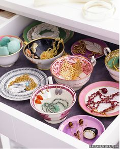 the prettiest idea for jewellery storage out there. Hidden in a drawer but displayed beautifully on those plates and dishes.