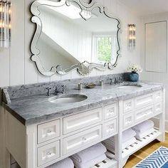 Beach Style Bathroom with Large Venetian Mirror