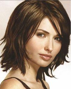 soft layers and side bangs on medium length hair