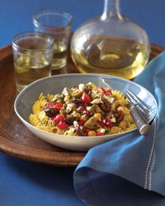 Mediterranean Olive Toss, a tasty of medley of tomatoes, garbanzo beans, capers, garlic, herbs, balsamic vinegar and feta. Make it ahead, then serve it over pasta, atop baguette, or in a salad.