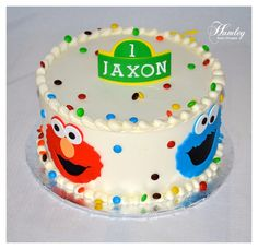 Sesame Street 1st birthday cake - not with green number/ name sign on top just his name in primary colors - Alex