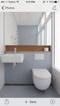 Wall hung basin and in wall cistern with shaving cabinet and timber recessed shelf