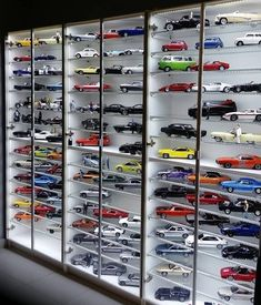 Incredible collection of diecast cars from TV and Movies. Well-lit display case and cool use of figurines. Toy Display, Display Case, Toddler Car Bed, Hot Wheels Display, Ultimate Garage, Model Train Layouts, Hot Wheels Cars, Garage Design, Diecast Model Cars