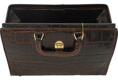Vintage doctor's bag made of dark brown embossed leather.