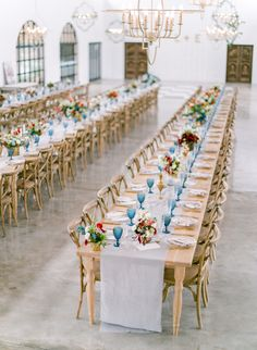 A colorful South African wedding held at Bordeaux Game Farm, featuring a rustic-chic style with pops of red, blue and gold.