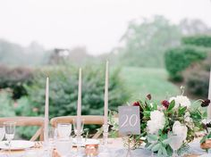Sandstone taper candles in crystal candleholders with marsala and burgundy flowers centerpiece    Virginia Countryside Wedding in The Plains | Stephanie & Max — EAST MADE EVENT COMPANY | Baltimore Maryland Fine Art Destination Wedding Planner | Julie Paisley Photography