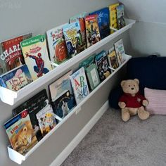 this idea - using gutters for bookshelves. A DIY bookshelf made with a rain gutter - Ganz Parent Club Guest PostLove this idea - using gutters for bookshelves. A DIY bookshelf made with a rain gutter - Ganz Parent Club Guest Post Gutter Bookshelf, Bookshelves, Diy Pour Enfants, Playroom Organization, Organizing Books, Toy Rooms, Kid Spaces, Getting Organized, Kids Bedroom