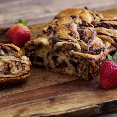 A flavorful and absolutely delicious bread to help bring happiness to this holiday season! With chocolate swirls, bursts of sweet raisins, and crunchy walnuts, you'll want to make more than one loaf.