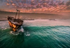 A dramatic sunset is the perfect backdrop for this shipwreck off the Cape L'Algulhas headland in South Africa.