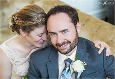 Cute cuddly wedding day portrait on a gold velvet couch at the Cooper Lounge inside Union Station in downtown Denver Colorado. - April O'Hare Photography http://www.apriloharephotography.com