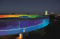 """""""Your rainbow panorama"""" of the Danish-Icelandic artist Olafur Eliasson. The new project was opened on the 28th of May 2011 on the top of the ARoS Aarhus Kunstmuseum in Århus, Denmark. Permanent circular vivid walkway of a 150 meters long, 3 meters wide by 3 meters high, gives a 360° colorful view of the city"""