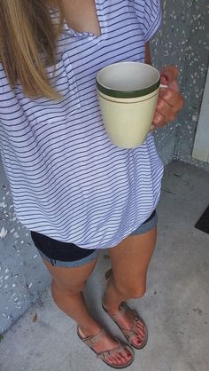 I like how simple this outfit is; basic striped top, jean shorts, and birkenstocks. -RLV