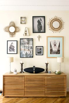 I want to do a similar wall collage in the living room. Shapes and placement inspiration.