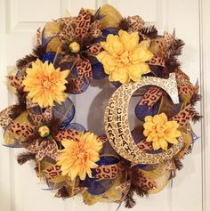 """The Cleary Cheetahs"" school colors deco mesh wreath!  Contact me through my website to order any custom wreath!"