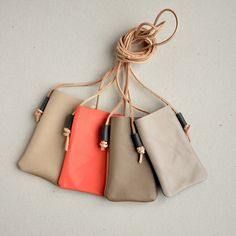Leather two-tone cell phone cases by // Between the Lines //, via Flickr