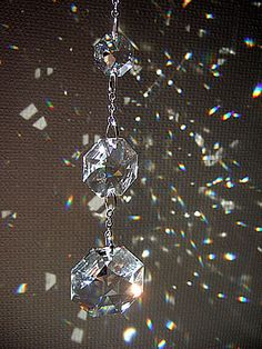 Crystals, glass beads, tiny bells - things that make sparkly, jingly dangly things that catch the sun and breezes in the screen porch. Crystal Mobile, Chandelier Art, Hanging Crystals, Beautiful Lights, Suncatchers, Wind Chimes, Swarovski Crystals, Glass Art, Glass Beads